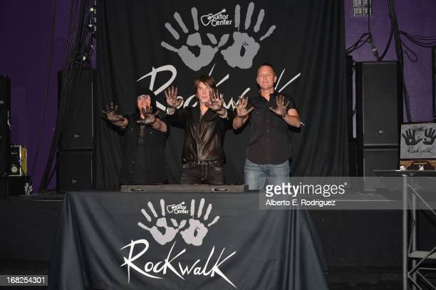 Goo Goo Dolls band members Robby Takac John Rzeznik and Mike Malinin attend a ceremony inducting The Goo Goo Dolls into the Guitar Center RockWalk at...