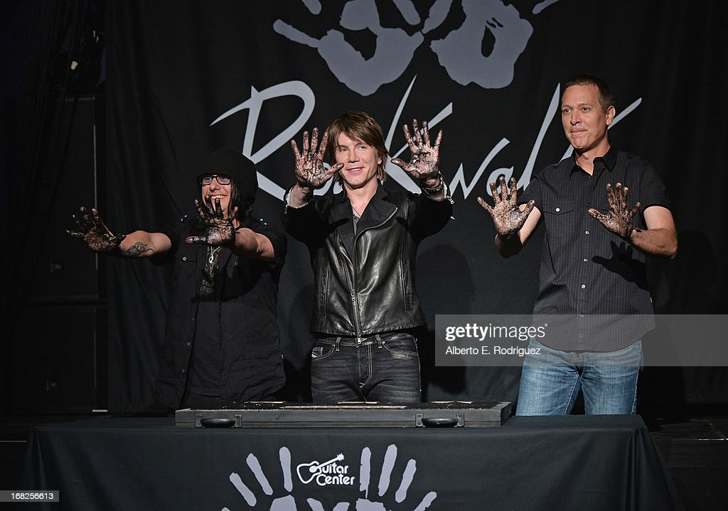Goo Goo Dolls band members <a gi-track='captionPersonalityLinkClicked' href=/galleries/search?phrase=Robby+Takac&family=editorial&specificpeople=778886 ng-click='$event.stopPropagation()'>Robby Takac</a>, <a gi-track='captionPersonalityLinkClicked' href=/galleries/search?phrase=John+Rzeznik&family=editorial&specificpeople=220876 ng-click='$event.stopPropagation()'>John Rzeznik</a> and <a gi-track='captionPersonalityLinkClicked' href=/galleries/search?phrase=Mike+Malinin&family=editorial&specificpeople=883519 ng-click='$event.stopPropagation()'>Mike Malinin</a> attend a ceremony inducting The Goo Goo Dolls into the Guitar Center RockWalk at Guitar Center on May 7, 2013 in Hollywood, California.