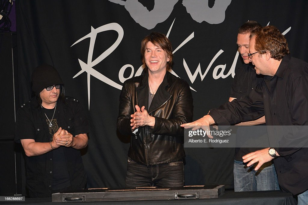 Goo Goo Dolls band members Robby Takac, John Rzeznik, Mike Malinin and Rockwalk director Dave Weiderman attend a ceremony inducting The Goo Goo Dolls into the Guitar Center RockWalk at Guitar Center on May 7, 2013 in Hollywood, California.