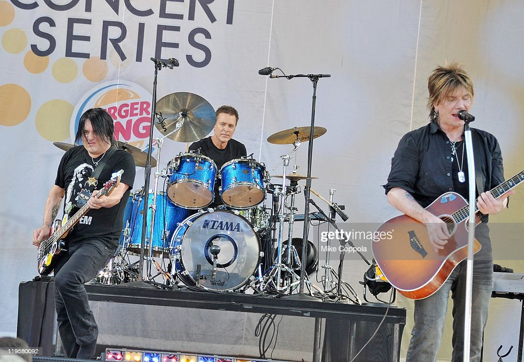 Goo Goo Dolls bass player Robby Takac, drummer Mike Malinin, and singer/guitar player John Rzeznik perform on ABC's 'Good Morning America' at Rumsey Playfield, Central Park on July 22, 2011 in New York City.