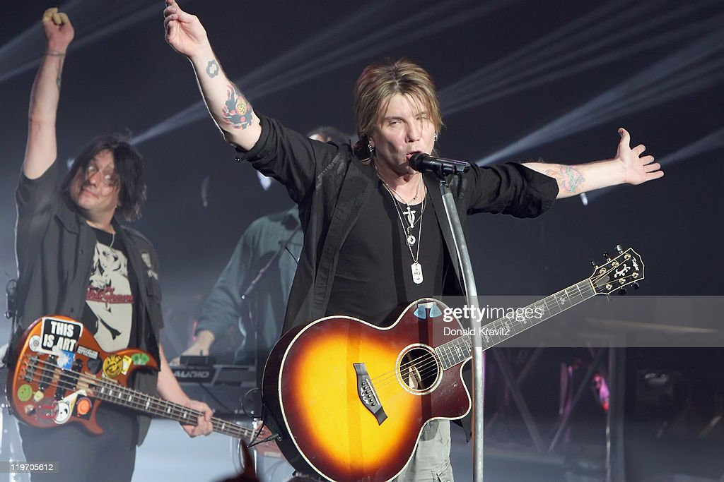 Goo Goo Dolls guitarist Robby Takac (L) and lead singer John Rzeznik performs at the Tropicana Casino on July 23, 2011 in Atlantic City, New Jersey.