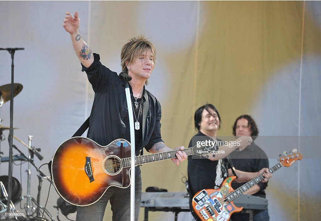 Goo Goo Dolls singer/guitar player John Rzeznik (L) and bass player Robby Takac perform on ABC's 'Good Morning America' at Rumsey Playfield, Central Park on July 22, 2011 in New York City.