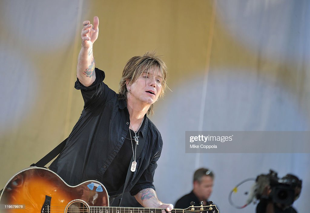 Goo Goo Dolls singer/guitar player John Rzeznik performs on ABC's 'Good Morning America' at Rumsey Playfield, Central Park on July 22, 2011 in New York City.