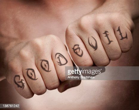 Good and evil fist tattoos : Stock Photo