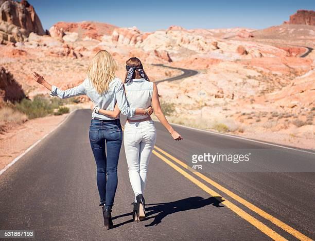 Good Bye! Two Women walking down a Desert Road