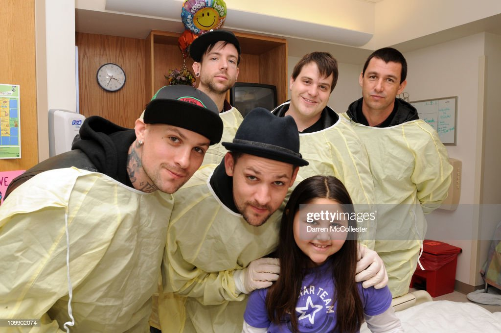 Good Charlotte band members Benji Madden Billy Martin Joel Madden Paul Thomas and Dean Butterworth spread cheer to patient Lauren March 9 2011 at...