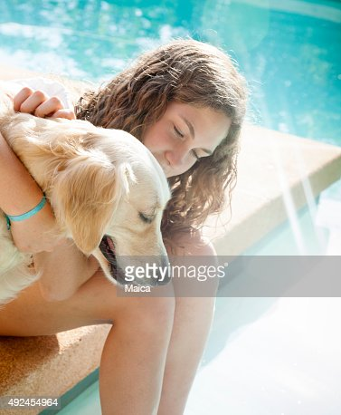 Good friends, child and dog hugging