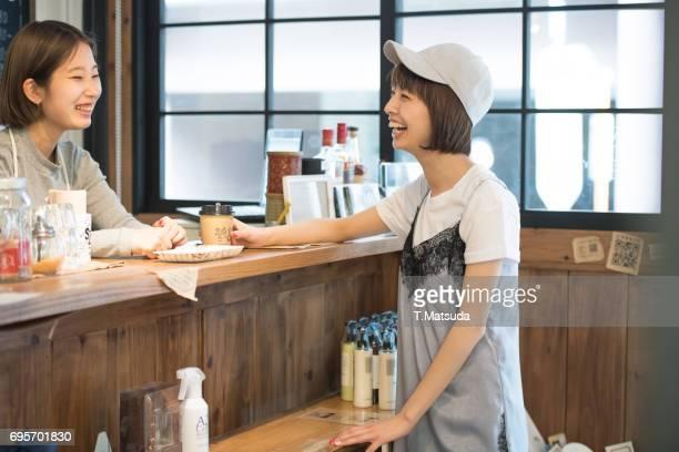 Good friends talk in cafe