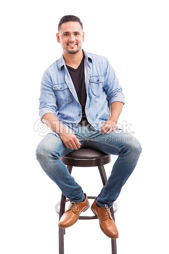 Good Looking Man Sitting In A Chair Stock Photo Thinkstock