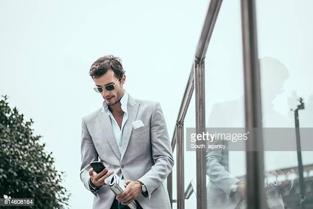 Good looking man using mobile