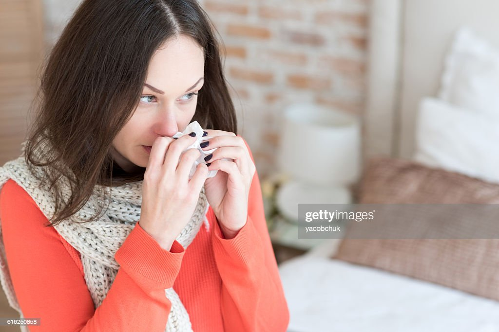 Good looking pessimistic woman suffering from running nose : Foto de stock