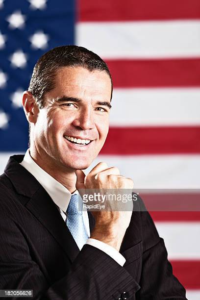 Good looking politician or VIP smiles with Stars and Stripes