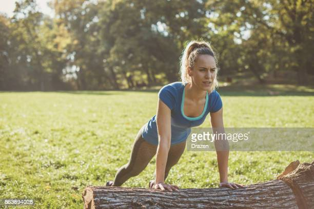 Good looking woman exercising in nature