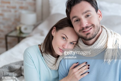 Good looking young woman sitting with her boyfriend : Foto de stock