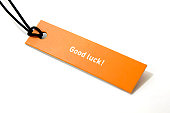 'good luck' text on orange label