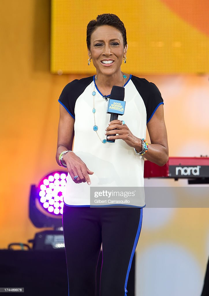 Good Morning America anchor <a gi-track='captionPersonalityLinkClicked' href=/galleries/search?phrase=Robin+Roberts+-+Television+Anchor&family=editorial&specificpeople=4439371 ng-click='$event.stopPropagation()'>Robin Roberts</a> on stage during Selena Gomez performance during ABC's 'Good Morning America' at Rumsey Playfield on July 26, 2013 in New York City.
