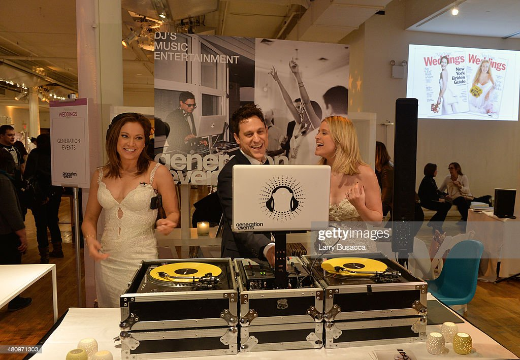 Good Morning America's Ginger Zee and Sara Haines help program at the music station during the New York Magazine's New York Weddings Event at Metropolitan Pavilion on March 27, 2014 in New York City.