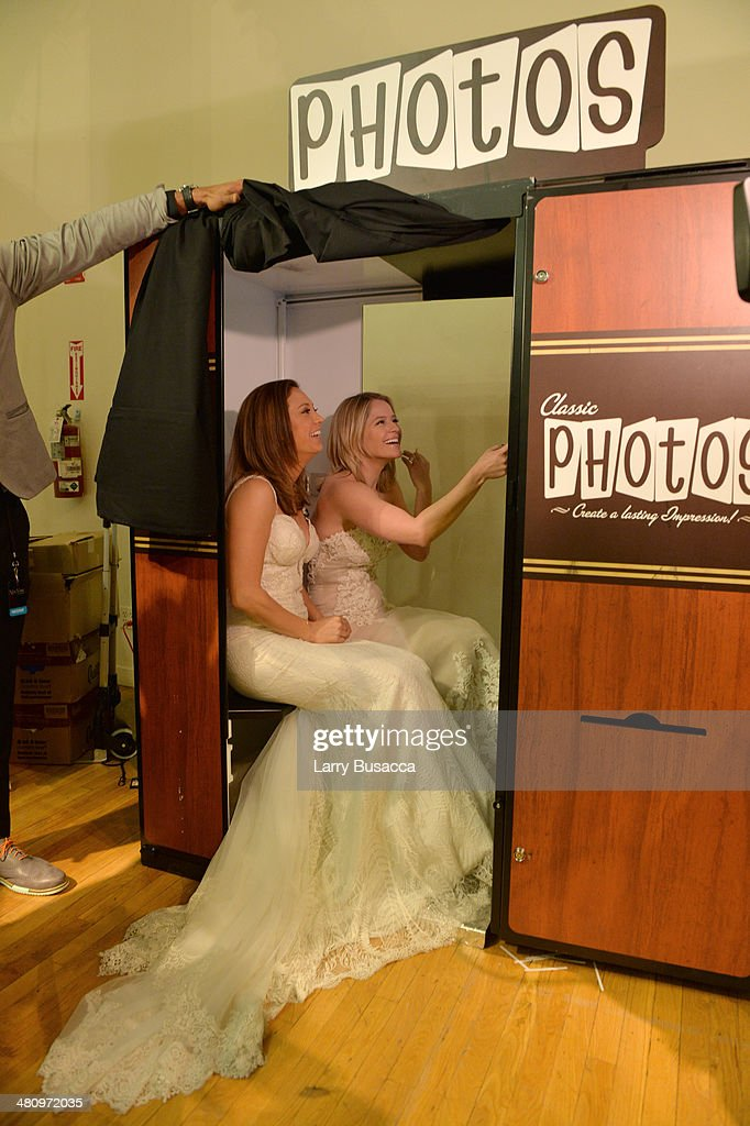 Good Morning America's Ginger Zee and Sara Haines pose in a photo booth during the New York Magazine's New York Weddings Event at Metropolitan Pavilion on March 27, 2014 in New York City.