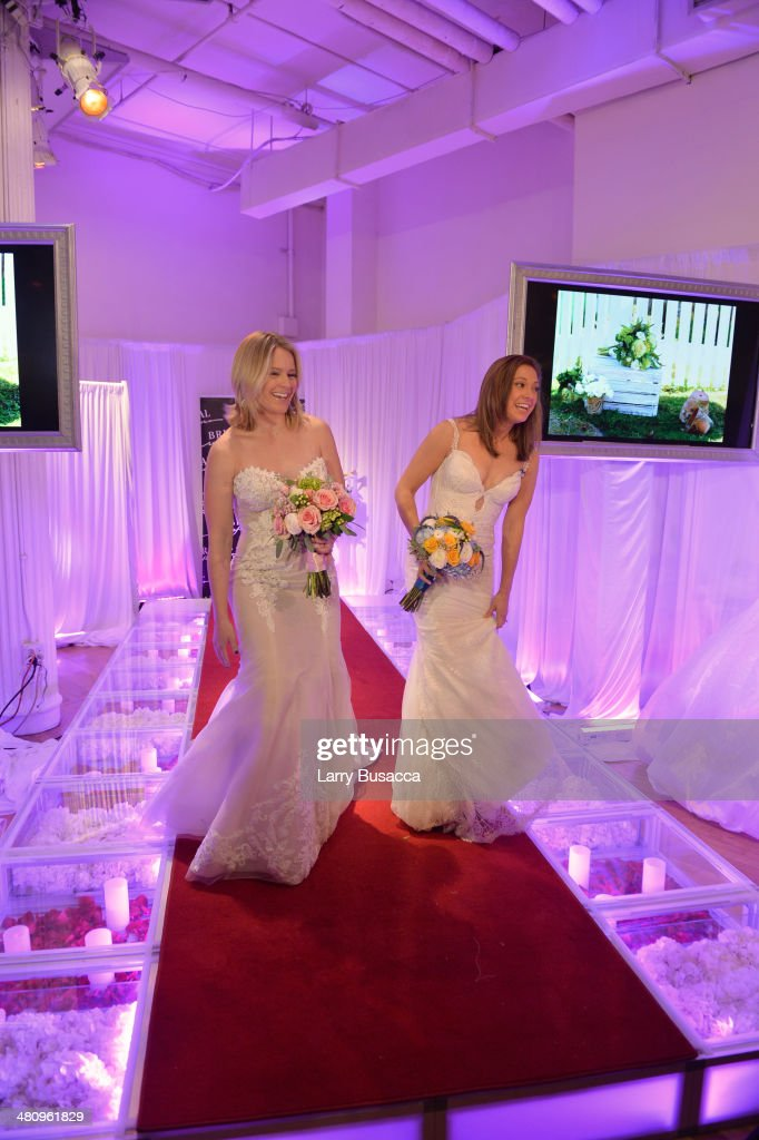 Good Morning America's Sara Haines and Ginger Zee are seen in wedding dresses during the New York Magazine's New York Weddings Event at Metropolitan Pavilion on March 27, 2014 in New York City.