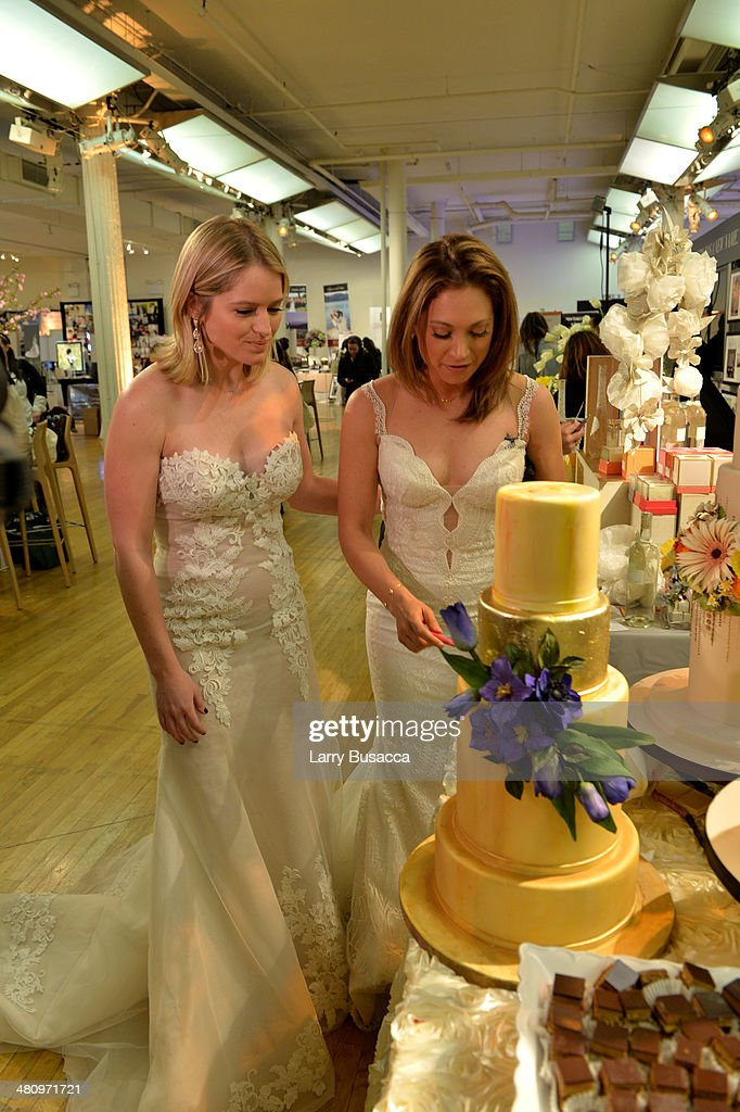 Good Morning America's Sara Haines and Ginger Zee choose the best wedding cake during the New York Magazine's New York Weddings Event at Metropolitan Pavilion on March 27, 2014 in New York City.