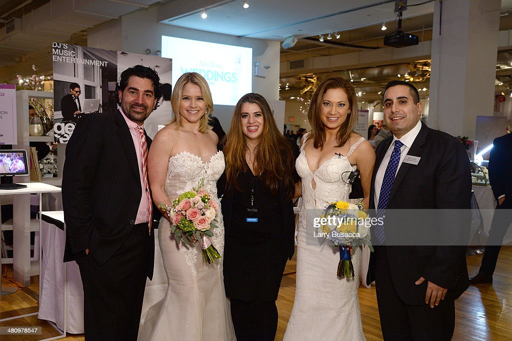 Good Morning America's Sara Haines (2nd L) and Ginger Zee (2nd R) pose with guests during the New York Magazine's New York Weddings Event at Metropolitan Pavilion on March 27, 2014 in New York City.