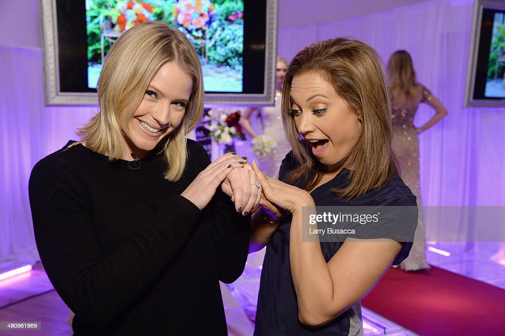Good Morning America's Sara Haines and Ginger Zee try on jewelry during the New York Magazine's New York Weddings Event at Metropolitan Pavilion on March 27, 2014 in New York City.