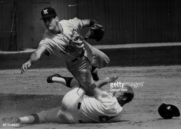 Good Try But Still A Double Play Denver's Tom Tischinski slams a leg into second baseman Tony Larussa of Vancouver in an attempt to break up double...