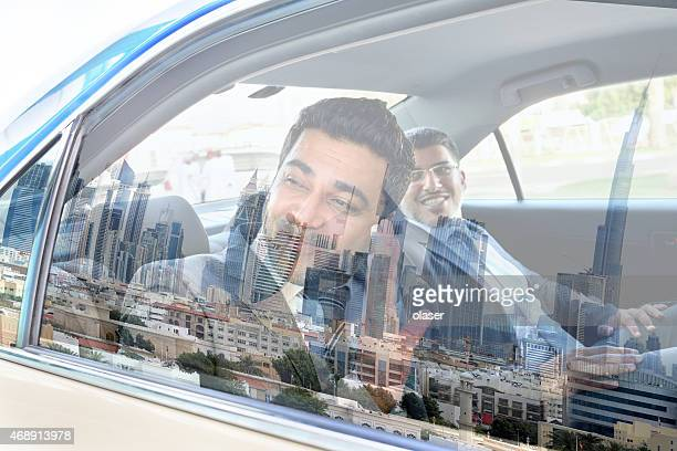 Goodbye Dubai, two arab business men in Taxi