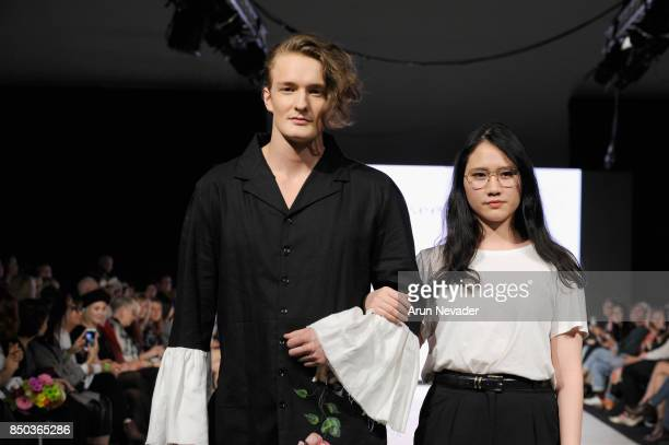 Goodbye Icelander VCC fashion designer Yuting Yeh walks the runway with a model at 2017 Vancouver Fashion Week Day 3 on September 20 2017 in...
