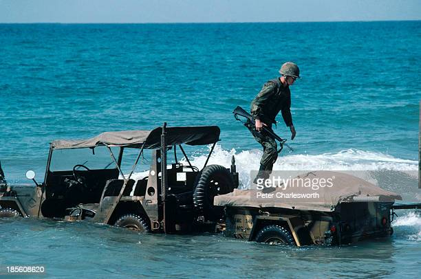 Goodbye Lebanon quagmired to the end one of the last US Marines to leave the country walks to shallow water after stalling his jeep while trying to...
