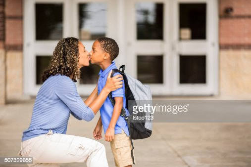 Goodbye. Little boy kisses mom on first day of school.