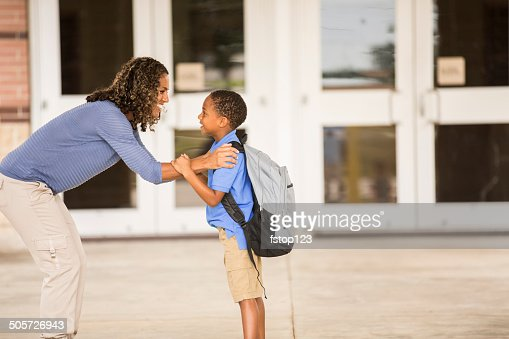 Goodbye mom. Little boy on his first day of school.