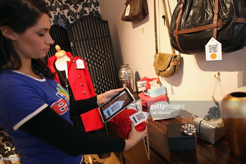 Goods are scanned in the new Ebay store on December 1, 2011 in central London, England. Ebay have launched the first ever quick response code shopping emporium allowing customers to browse in store and then order online using mobile phones and tablets inside the boutique whilst it is open for the next five days.