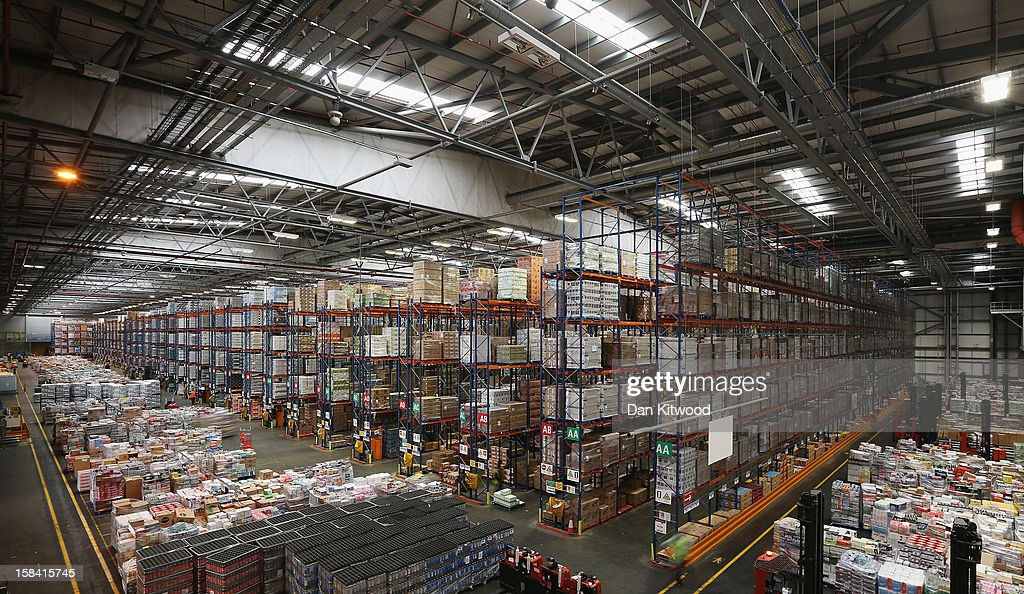 Goods are stored at Sainsbury's Waltham Point distribution depot on December 14, 2012 in Waltham Abbey, England. The 700,000 square foot fulfillment factory depot is the largest of 23 operated by Sainsbury's to service their stores. Approximately Twelve hundred people work in the factory which makes over 1800 deliveries a week to around 90 stores in the London, Hertfordshire and Essex region. The depot is gearing up for the final weeks before Christmas, which is the busiest time of the year.
