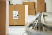 Goods Moving On Conveyor Belt In Distribution Warehouse