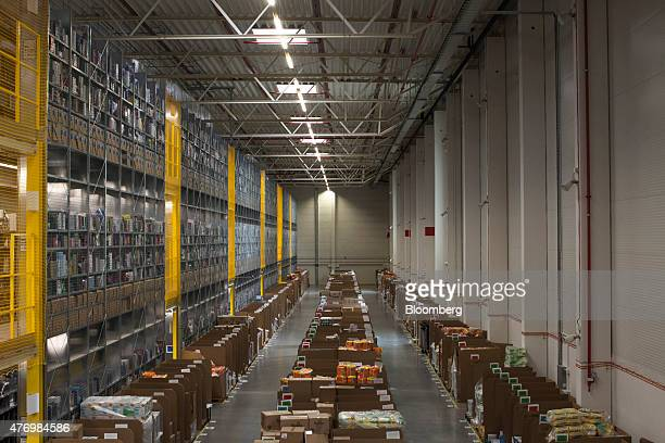 Goods sit on the floor of an inbound area storehouse next to the wall of a picking tower at the Amazoncom Inc fulfillment center in Poznan Poland on...