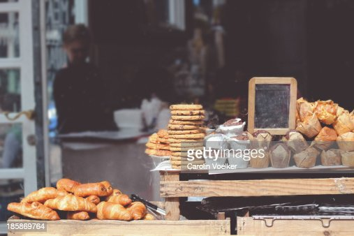 Goods stacked in a shop window of a bakery