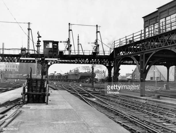 A goods train crossing the points outside Newcastle station on the last day semaphore arm signals were used on the East Coast mainline 7th May 1955