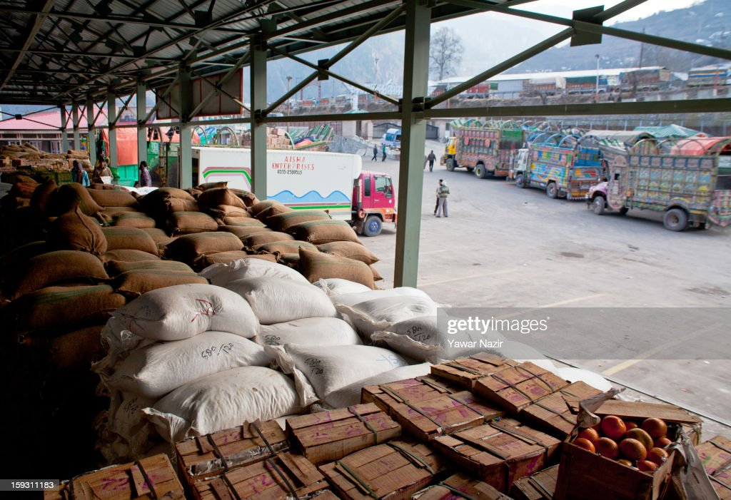 Goods unloaded from Pakistani vehicles sit at the trade facilitation centre in the border area near Uri on January 11, 2013 in Salamabad, 120 km (75 miles) northwest of Srinagar, the summer capital of Indian Administered Kashshmir, India. People living in the mountainous region along the Line of Control (LOC), a military line that divides Indian-administered Kashmir from the Pakistan-administered Kashmir have continually been at risk due to hostility between the armies of the two rival nations, but trade has been carried out smoothly across the Line of Control in North Kashmir. Two Indian and two Pakistani soldiers have been killed in the last week near the Line of Control dividing Kashmir, with both countries blaming each other for the escalating tension.