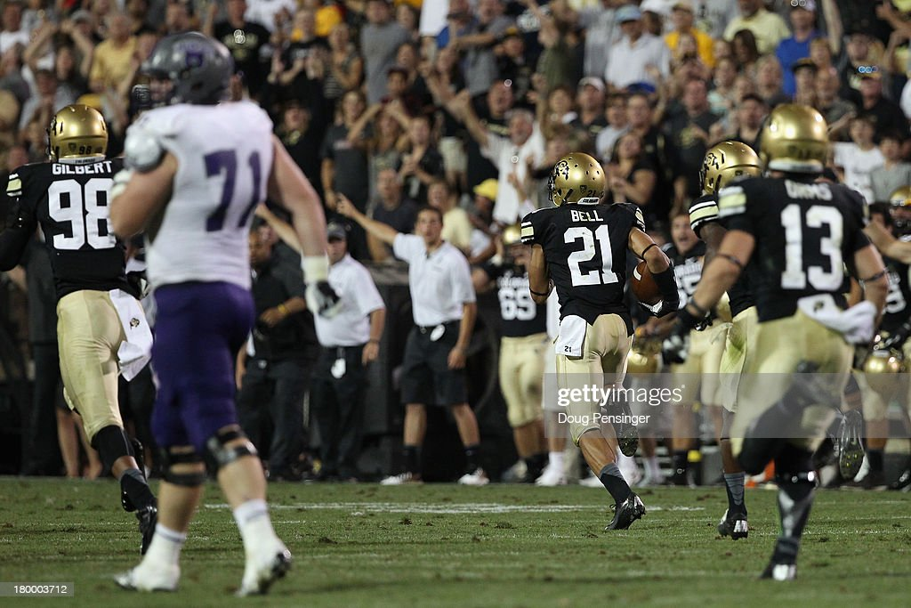 D.D. Goodson #21 of the Colorado Buffaloes returns an interception of quarterback Wynrick Smothers #4 of the Central Arkansas Bears 79 yard for a touchdown to tie the score 24-24 in the fourth quarter at Folsom Field on September 7, 2013 in Boulder, Colorado. The Buffaloes defeated the Bears 38-24.