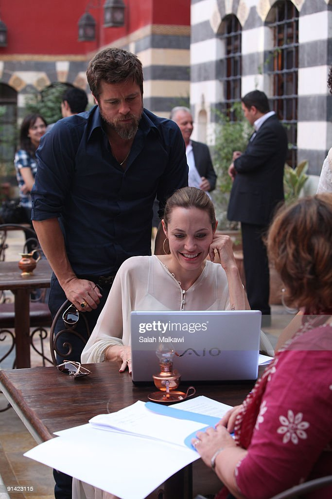 Goodwill Ambassador actress <a gi-track='captionPersonalityLinkClicked' href=/galleries/search?phrase=Angelina+Jolie&family=editorial&specificpeople=201591 ng-click='$event.stopPropagation()'>Angelina Jolie</a> and partner <a gi-track='captionPersonalityLinkClicked' href=/galleries/search?phrase=Brad+Pitt+-+Actor&family=editorial&specificpeople=201682 ng-click='$event.stopPropagation()'>Brad Pitt</a> spend time at a hotel after visiting an Iraqi refugee family living in a suburb on October 2, 2009 in Damascus, Syria. Jolie, traveling with partner Pitt, last visited Damascus in 2007.