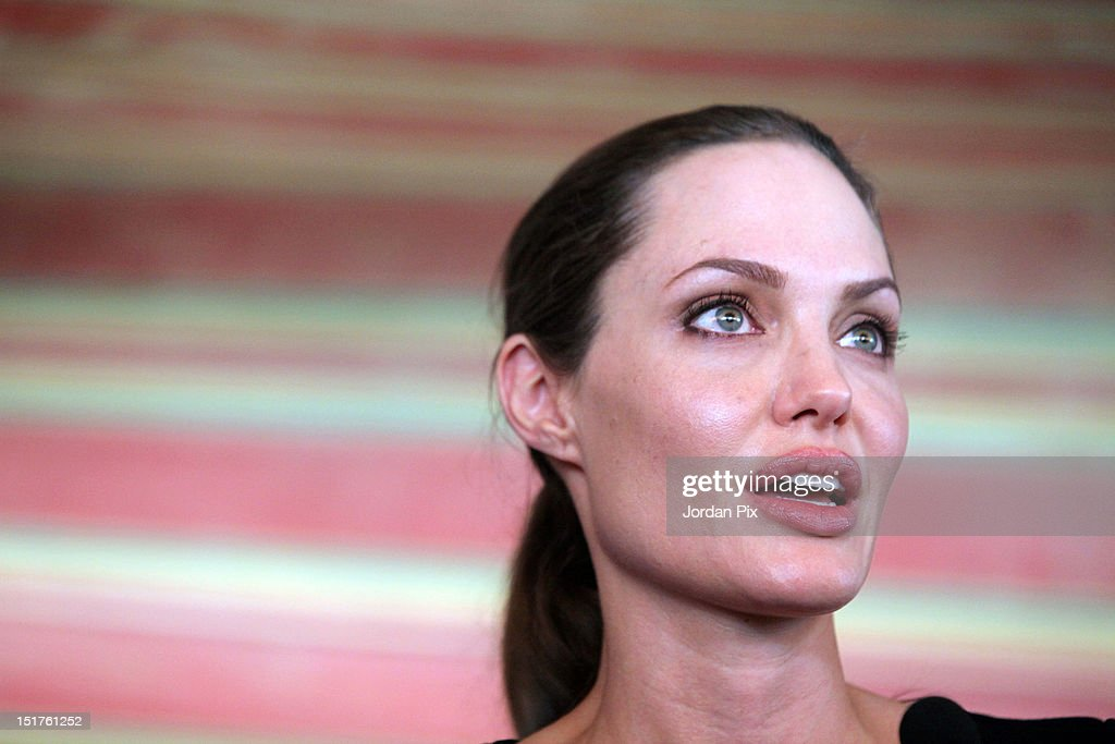 U.N. Goodwill Ambassador and Hollywood actress <a gi-track='captionPersonalityLinkClicked' href=/galleries/search?phrase=Angelina+Jolie&family=editorial&specificpeople=201591 ng-click='$event.stopPropagation()'>Angelina Jolie</a> holds a press conference with UNHCR High Commissioner Antonio Guterres during her visit to Al Zaatari camp for Syrian refugees accompanied by Jordanian Foreign Minister Nasser Judeh, on September 11, 2012 in Al Zaatari, Jordan.