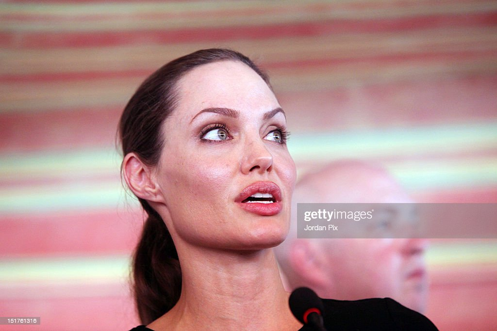 U.N. Goodwill Ambassador and Hollywood actress <a gi-track='captionPersonalityLinkClicked' href=/galleries/search?phrase=Angelina+Jolie&family=editorial&specificpeople=201591 ng-click='$event.stopPropagation()'>Angelina Jolie</a> holds a press conference with UNHCR High Commissioner Antonio Guterres (not pictured) during her visit to Al Zaatari camp for Syrian refugees accompanied by Jordanian Foreign Minister Nasser Judeh, on September 11, 2012 in Al Zaatari, Jordan.