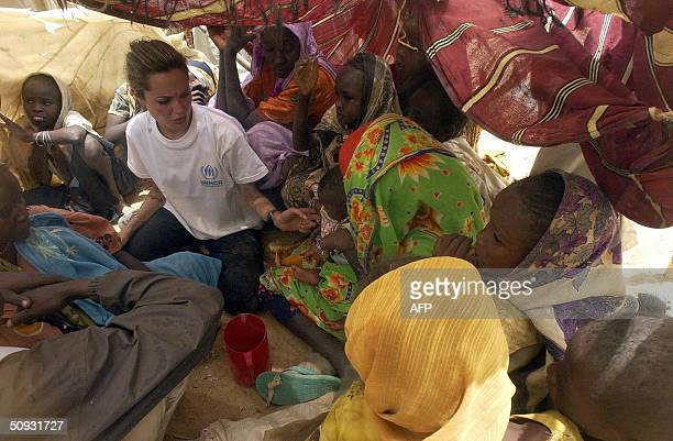 UNHCR goodwill ambassador Angelina Jolie meets 04 June 2004 Sudanese refugee women who have just crossed the border near Tine Chad The refugees are...
