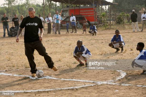 Goodwill Ambassador David Beckham plays football with a group of boys during his first field visit with UNICEF to Sierra Leone on January 19 2008...