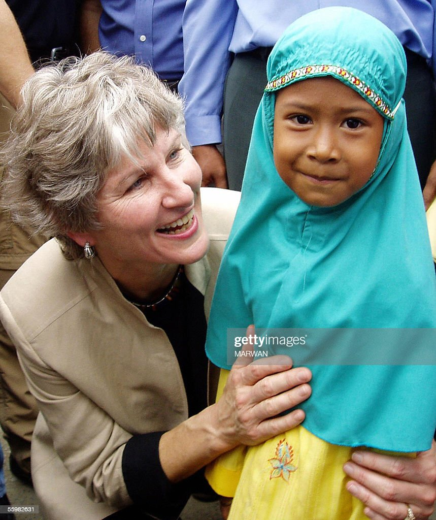 US goodwill envoy Karen Hughes greets an Acehnese child at a market during her visit in Banda Aceh 22 October 2005 Hughes made a brief visit to...