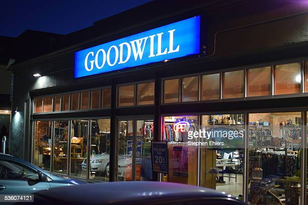 A Goodwill retail store front in the Capitol Hill neighborhood of Seattle Washington Cars are parked outside and thrift goods are seen through the...
