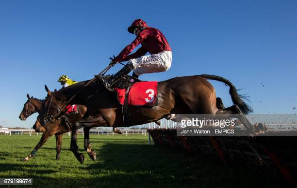 Goodwood Mirage ridden by Tony McCoy crashes through the last before overhauling The Green Ogre ridden by Tom Cannon to win The William Hill In The...