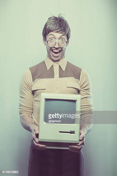 Goofy excited wearing nerdy IT Computer guy