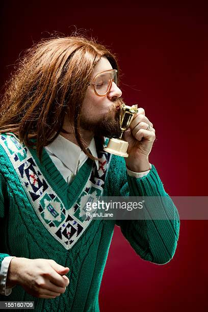 Goofy Nerd With Bad Sweater Kissing Trophy